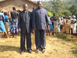 Pastor Teh *left* and pastor Chiambah Godlove